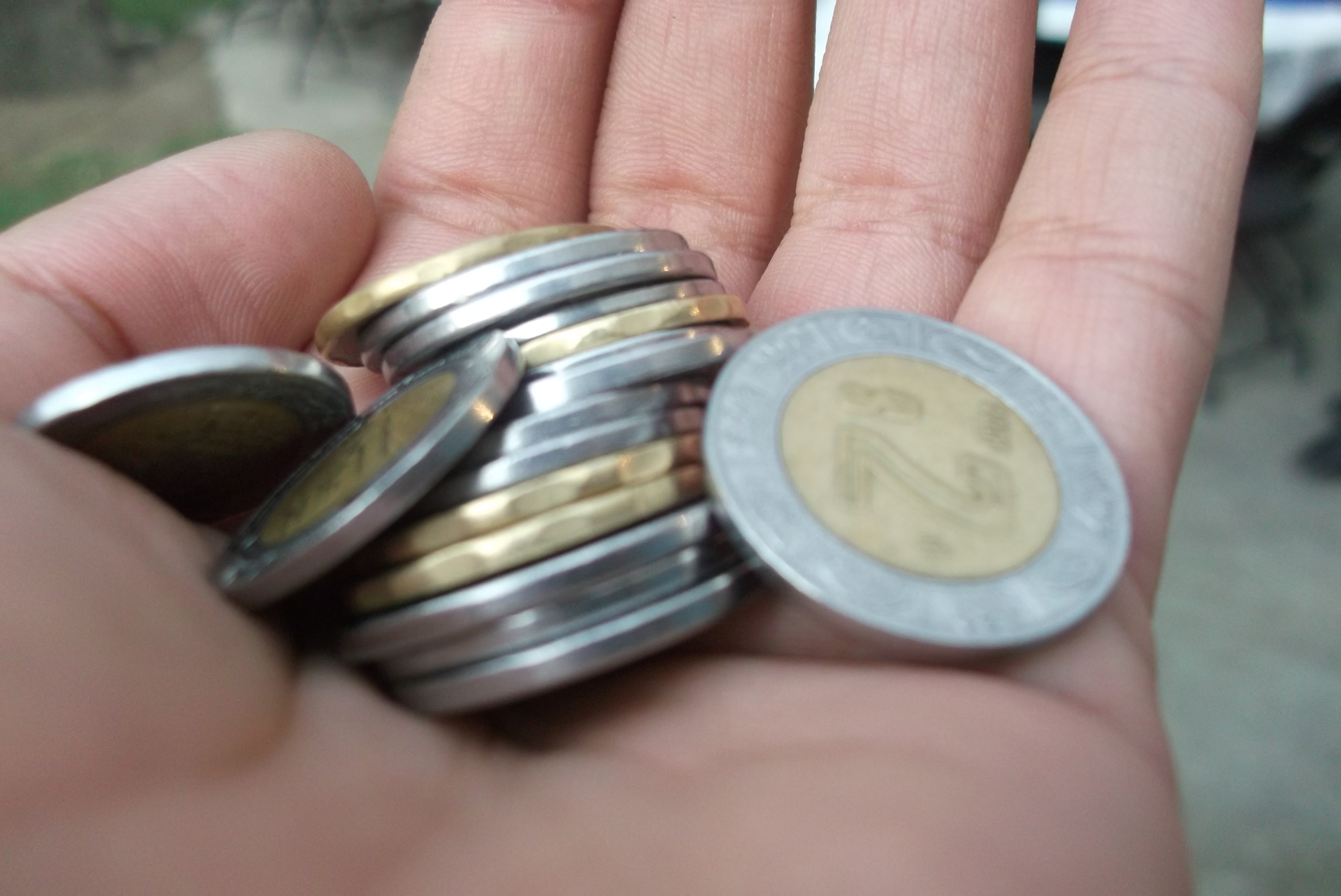 Monedas_en_la_mano Los autónomos se despiden del 21%